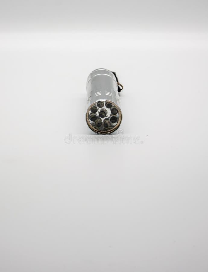 Lampe-torche argentée en métal d'isolement sur le fond blanc image stock