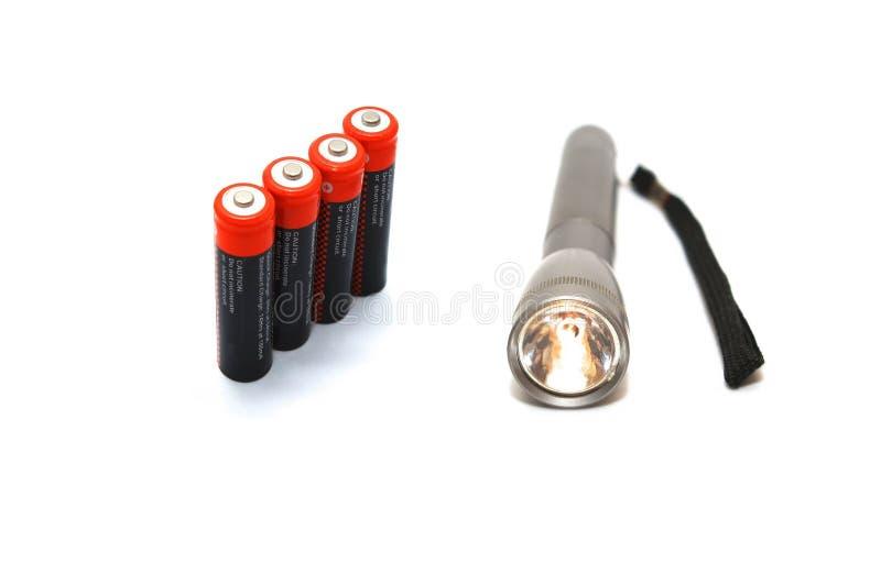 Lampe-torche avec des batteries photographie stock