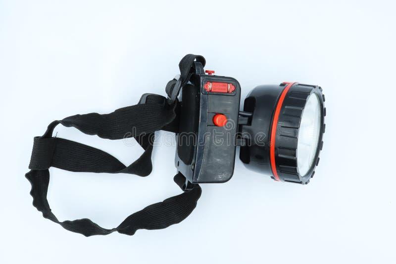 Lampe-torche principale d'isolement sur le fond blanc photographie stock libre de droits