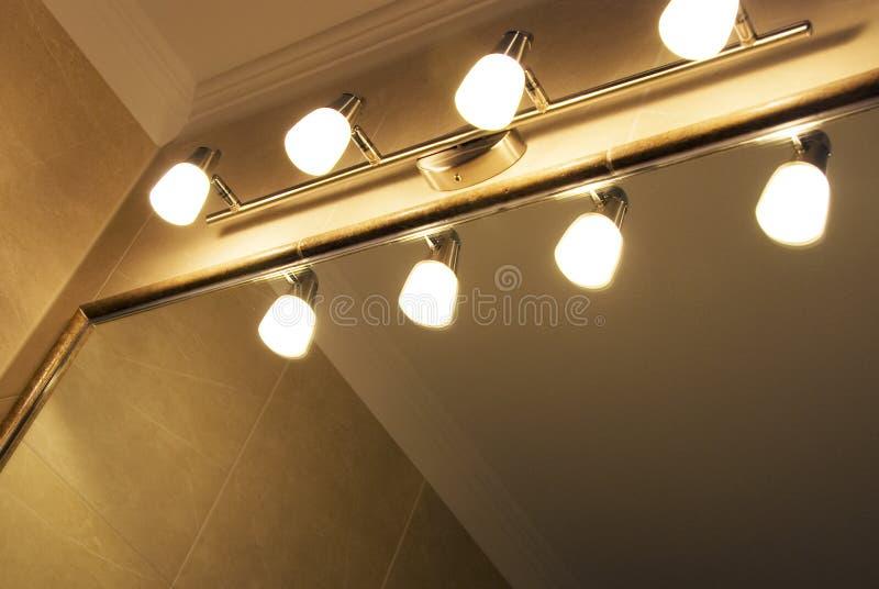 Lampen en spiegel stock foto's