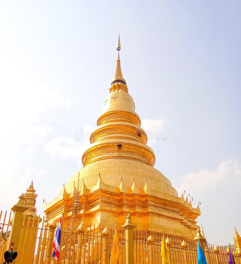LAMPHUN, THAILAND - Mar 21, 2018 at Wat Phra That Hariphunchai, beautiful golden pagoda with Lanna style temple in Lamphun royalty free stock photo