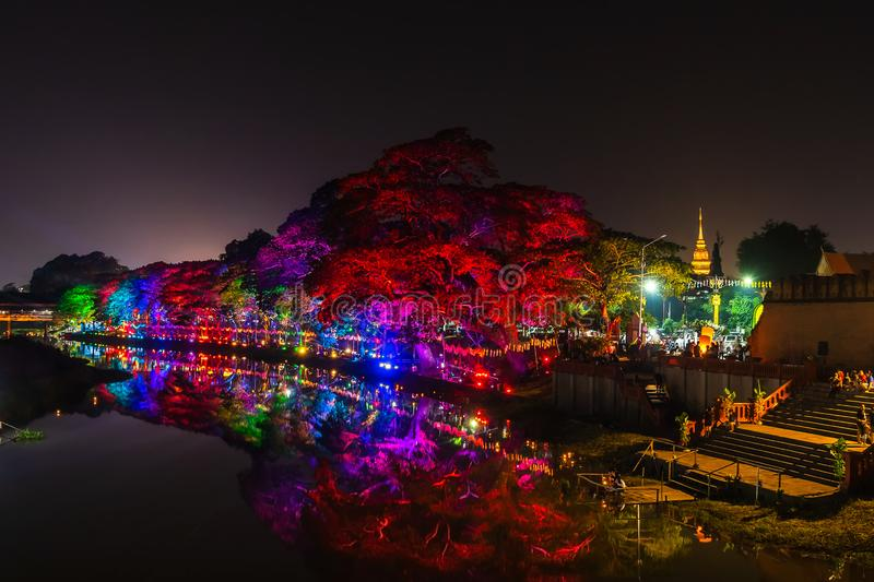 LAMPHUN, THAILAND - NOVEMBER 10, 2019 : Symphony of Lights is the spectacular light and sound show at City Wall beside the river royalty free stock photos