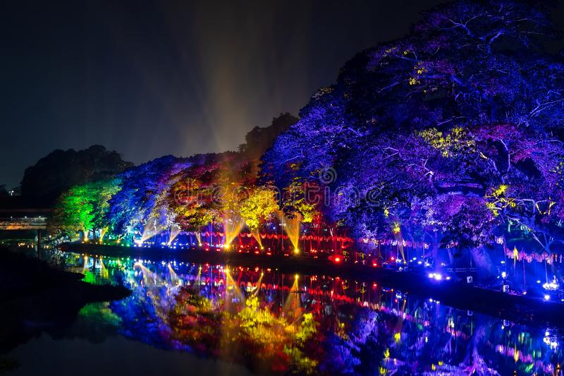 LAMPHUN, THAILAND - NOVEMBER 10, 2019 : Symphony of Lights is the spectacular light and sound show at City Wall beside the river stock photo