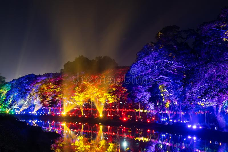 LAMPHUN, THAILAND - NOVEMBER 10, 2019 : Symphony of Lights is the spectacular light and sound show at City Wall beside the river stock photography