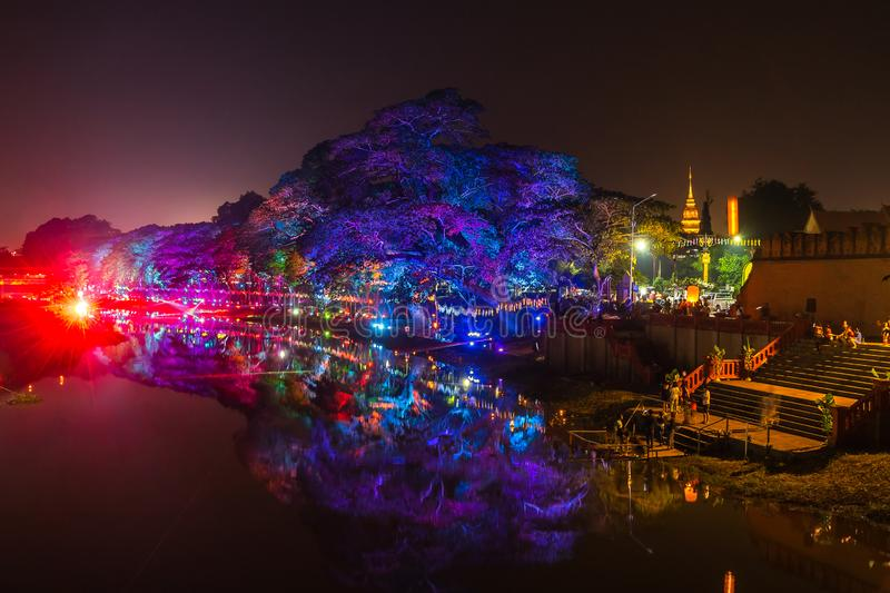 LAMPHUN, THAILAND - NOVEMBER 10, 2019 : Symphony of Lights is the spectacular light and sound show at City Wall beside the river stock photos