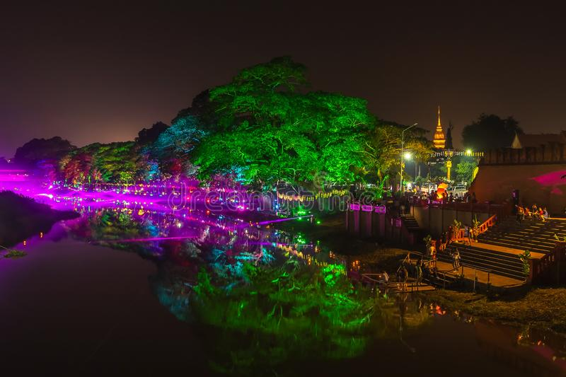 LAMPHUN, THAILAND - NOVEMBER 10, 2019 : Symphony of Lights is the spectacular light and sound show at City Wall beside the river stock image