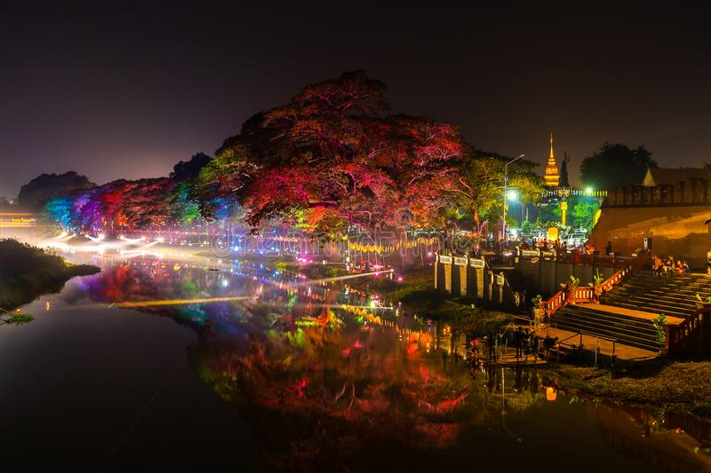 LAMPHUN, THAILAND - NOVEMBER 10, 2019 : Symphony of Lights is the spectacular light and sound show at City Wall beside the river royalty free stock image