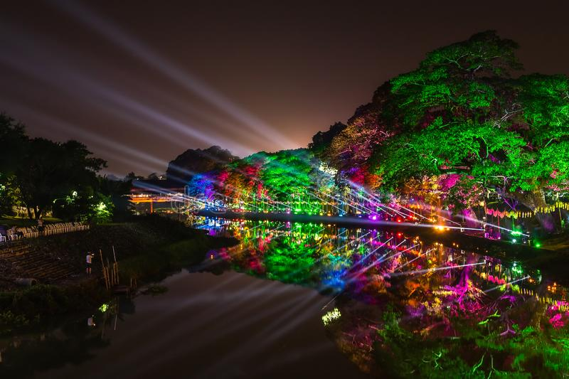 LAMPHUN, THAILAND - NOVEMBER 10, 2019 : Symphony of Lights is the spectacular light and sound show at City Wall beside the river royalty free stock images