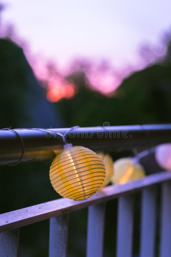 Lampions in the night: Garden party in summer. Colorful lampions outside, twilight hour, garden party, night, outdoors, decoration, summer, cozy, youth, weekend stock image