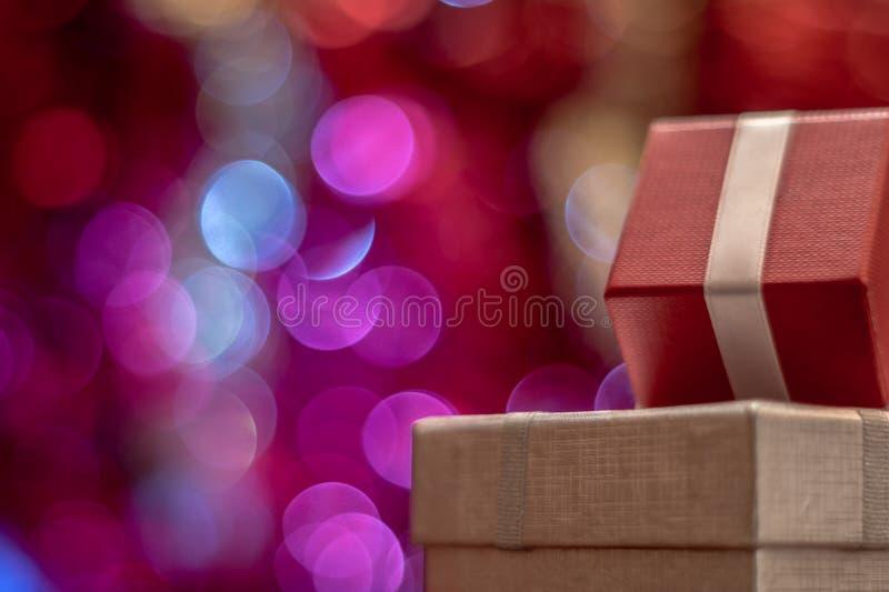 lampor för gåva för bakgrundsjul defocused royaltyfri foto