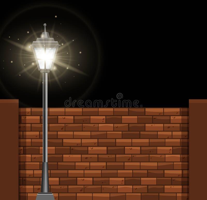 Lamppost en brickwall bij nacht royalty-vrije illustratie