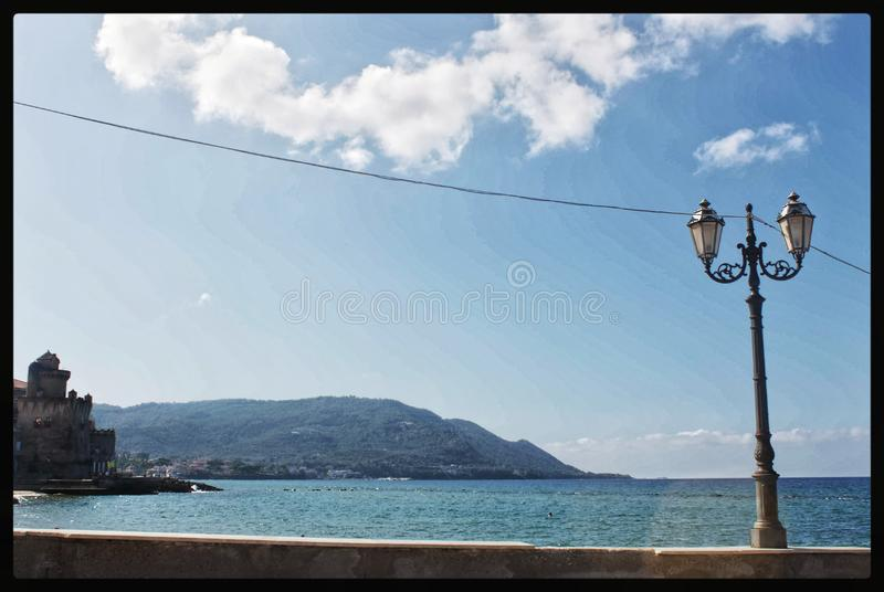 Lamppost on the sea royalty free stock image
