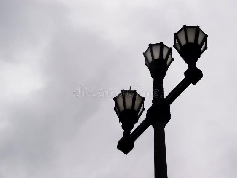Lampposts на заходе солнца стоковое фото rf