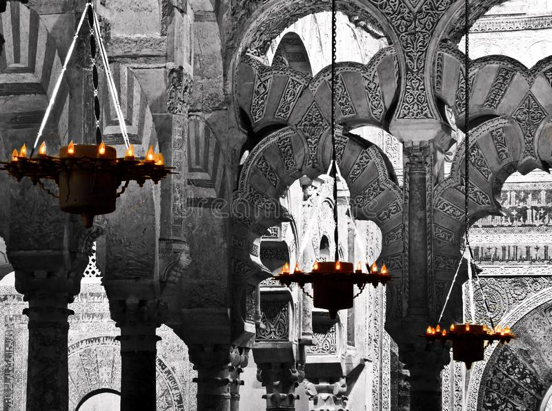 Lamps and arches of the Mosque of Cordoba Spain. 31/05/2011; Cordoba/Spain: Color lamps and black and white arches of the Mosque of Cordoba Spain royalty free stock photo