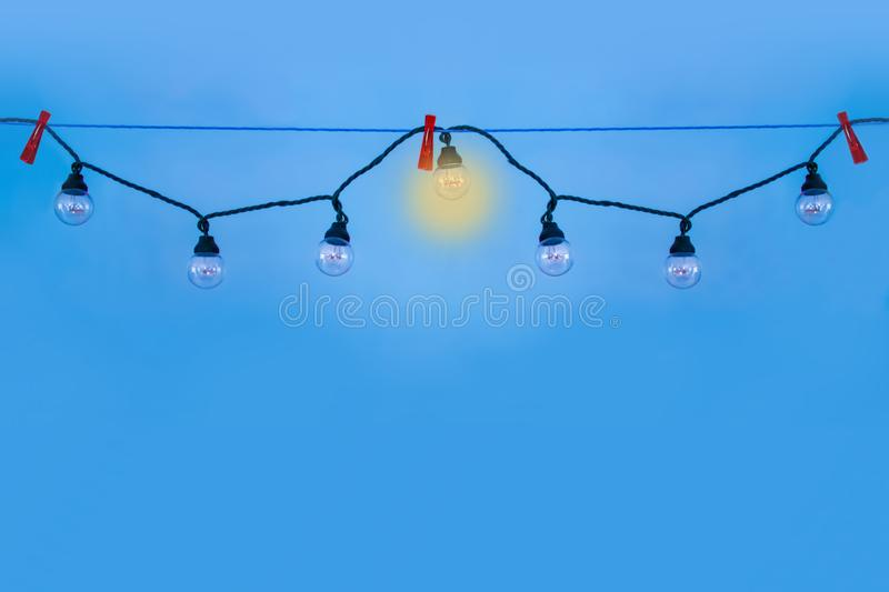 Lamps hanging in a garland. stock photo