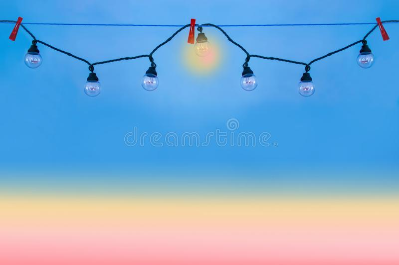 Lamps hanging in a garland. stock photos