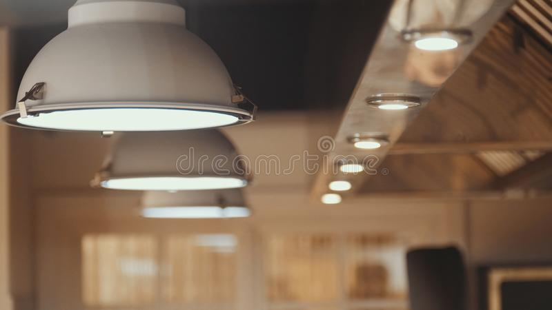 Lamps - professional kitchen equipment in restaraunt royalty free stock photography