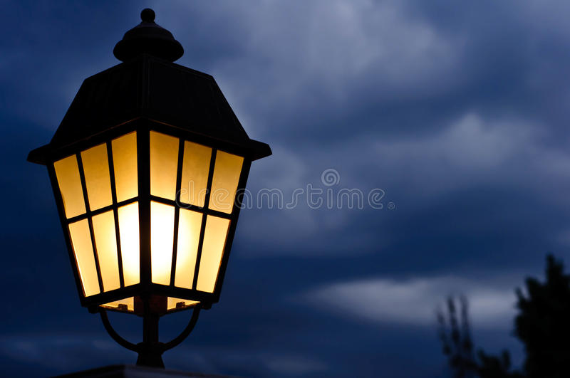 Lamps and rain clouds royalty free stock photo