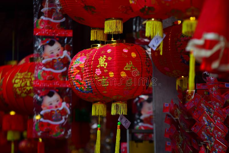 Lamps and red garments for use during Chinese New Year. The New Year`s Day of the Chinese people royalty free stock photo