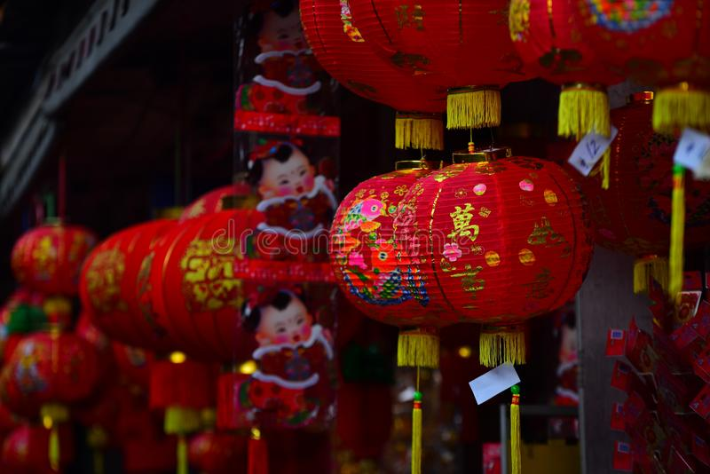 Lamps and red garments for use during Chinese New Year. The New Year`s Day of the Chinese people royalty free stock images