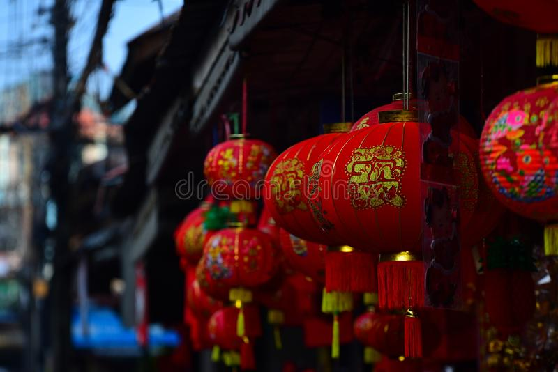 Lamps and red garments for use during Chinese New Year. The New Year`s Day of the Chinese people stock photography