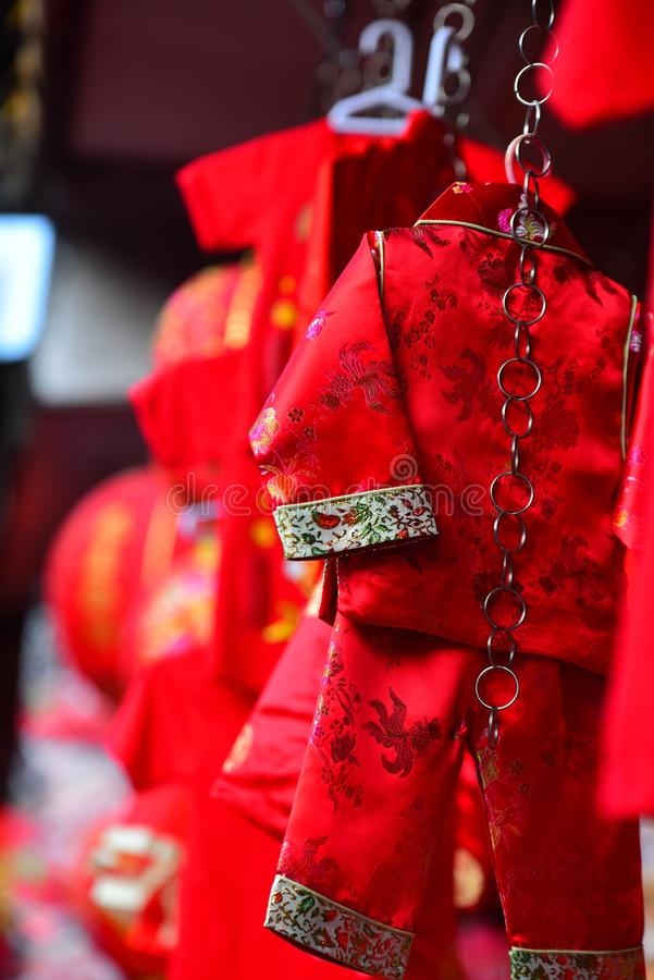 Lamps and red garments for use during Chinese New Year. The New Year`s Day of the Chinese people royalty free stock photos