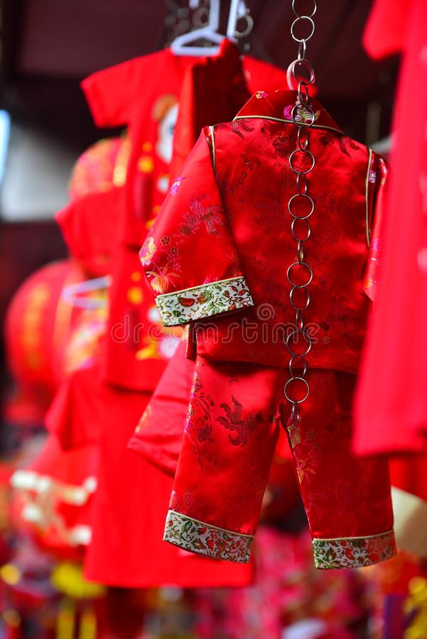 Lamps and red garments for use during Chinese New Year. The New Year`s Day of the Chinese people stock photos