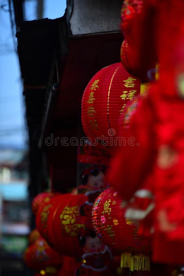 Lamps and red garments for use during Chinese New Year. The New Year`s Day of the Chinese people stock image