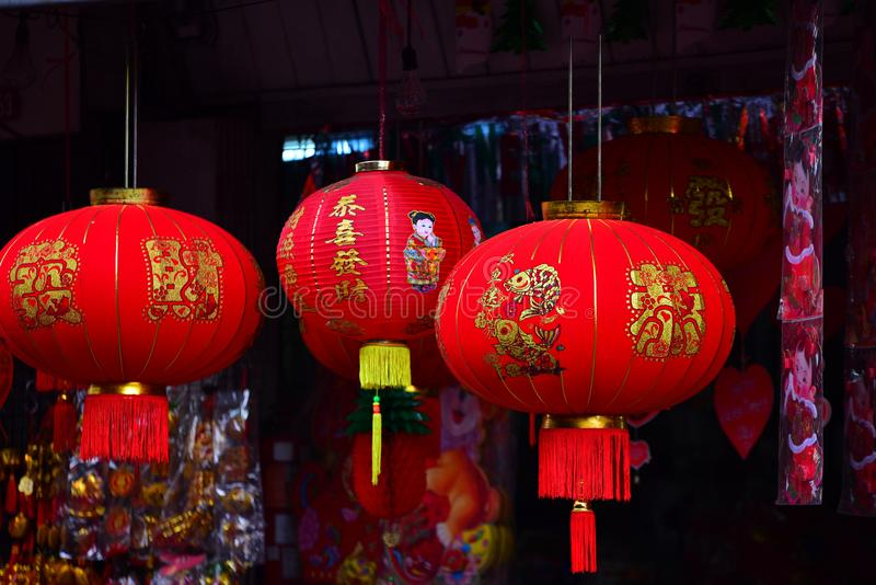Lamps and red garments for use during Chinese New Year. The New Year`s Day of the Chinese people stock images