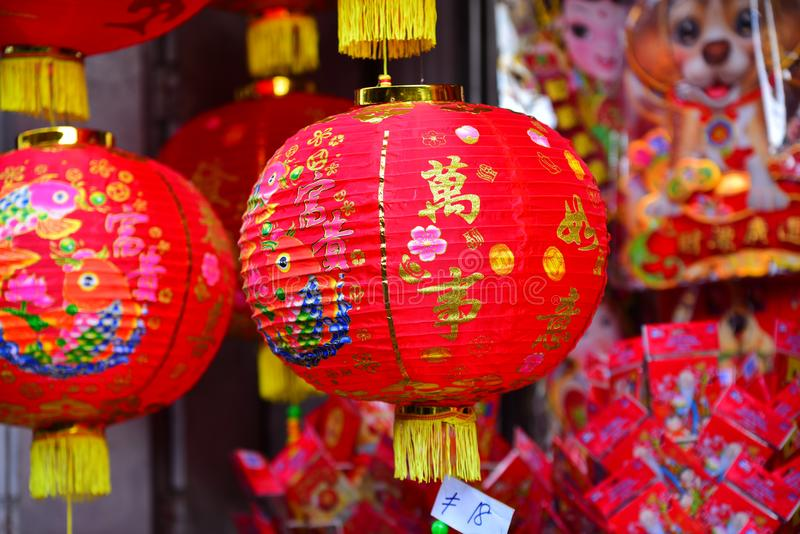 Lamps and red garments for use during Chinese New Year. stock images