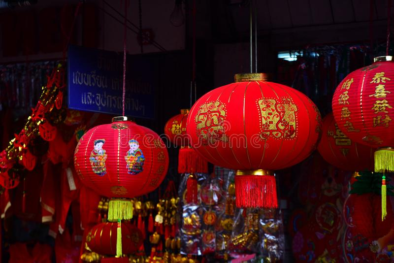 Lamps and red garments for use during Chinese New Year. The New Year`s Day of the Chinese people royalty free stock photography
