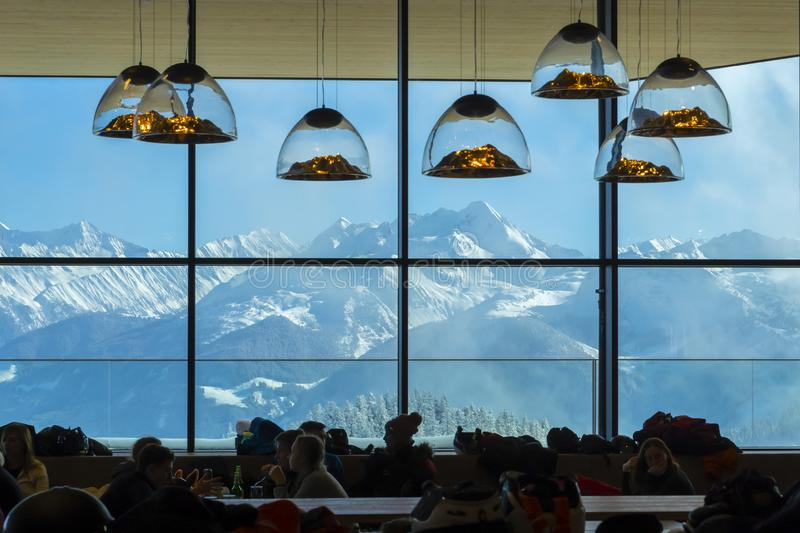 The lamps in shape like mountains in ski resort cafe in Austrian Alps stock photography