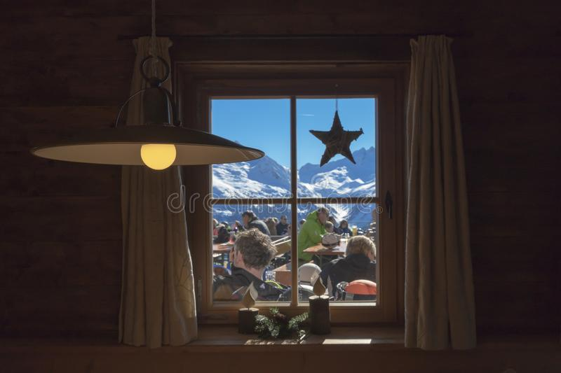 The lamps and window on ski resort cafe in Austrian Alps stock images