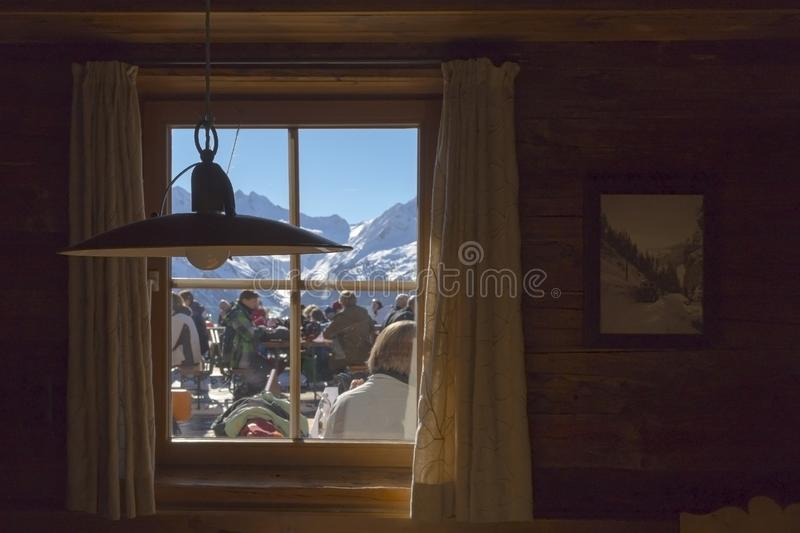 The lamp and window view on ski resort cafe in Austrian Alps stock image