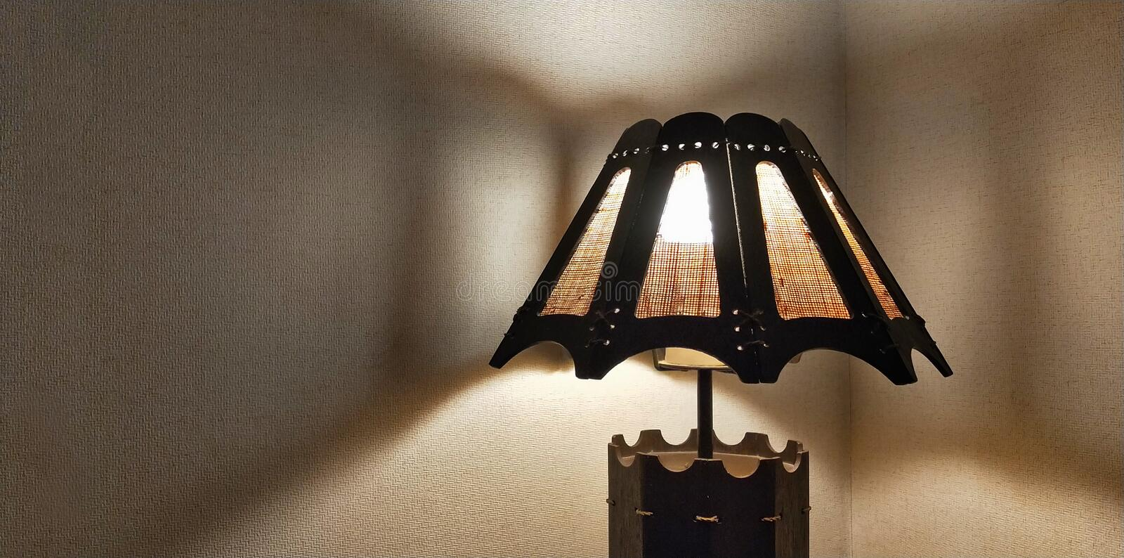 Lampshade lamp with shadow on the wall stock photos