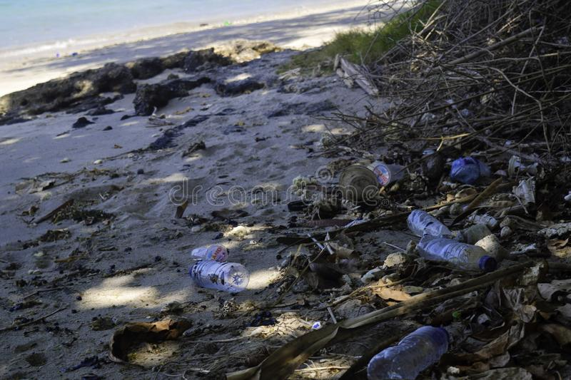 LAMPUNG, INDONESIA, JULY 2019 : Dirty sea sandy shore the Sea. Environmental pollution. Ecological problem - Pollutions and. Garbages on the beach royalty free stock image