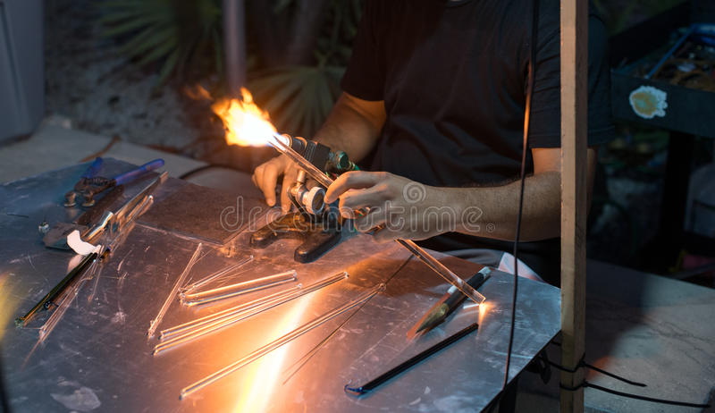 Lampworking and Glass Rods. Man Lampworking with Glass rods royalty free stock images