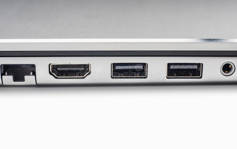 LAN , graphic , firewire and usb ports of laptop computer on wh royalty free stock photography