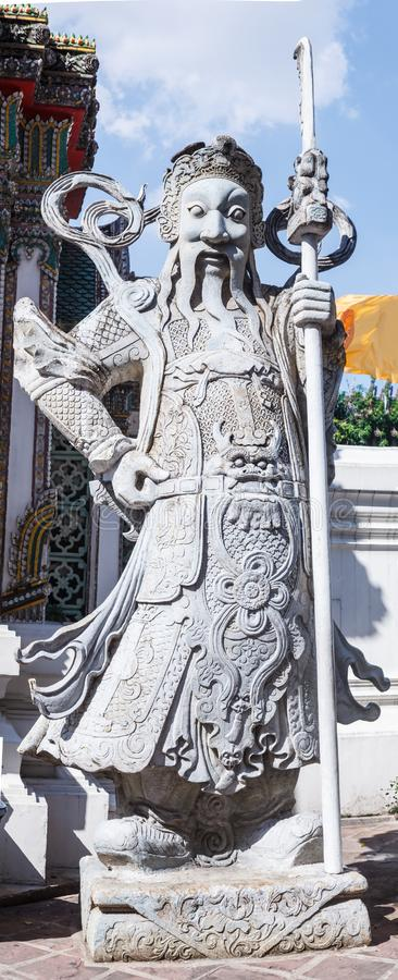 Lan Than Chinese Rock Giants with weapons represent noble warriors in Chinese opera-style garment in Wat Pho, Bangkok, Thailand. Chinese Stone Ballast royalty free stock photos