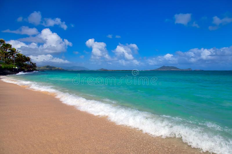 Lanai Beach on Oahu, Hawaii. A beautiful day at Lanai Beach on Oahu, Hawaii with white sand and turquoise water royalty free stock images