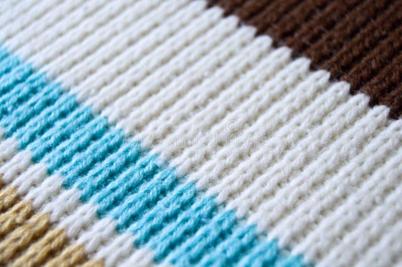 Lanas que hacen punto blancas y azules de Brown, fondos de la textura fotografía de archivo libre de regalías