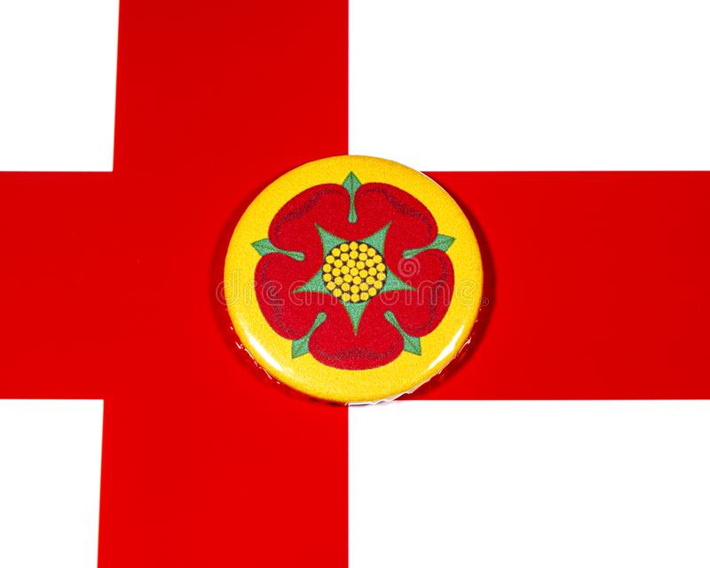 Lancashire in England. A badge portraying the flag of the English county of Lancashire pictured over the England flag royalty free stock photo