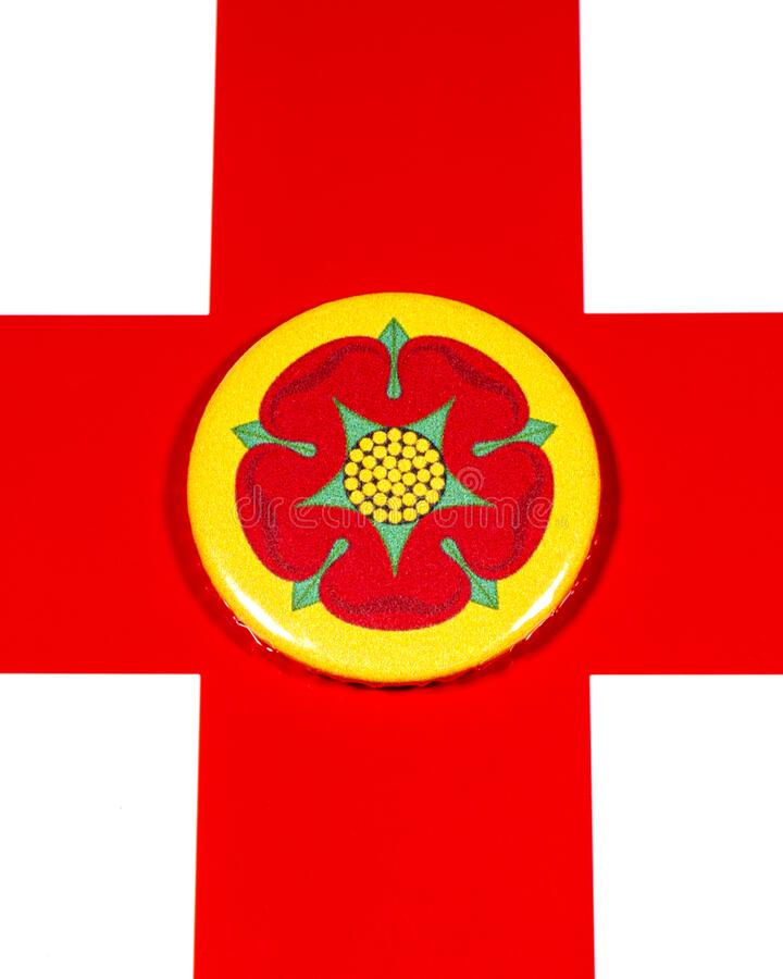 Lancashire in England. A badge portraying the flag of the English county of Lancashire pictured over the England flag stock photography