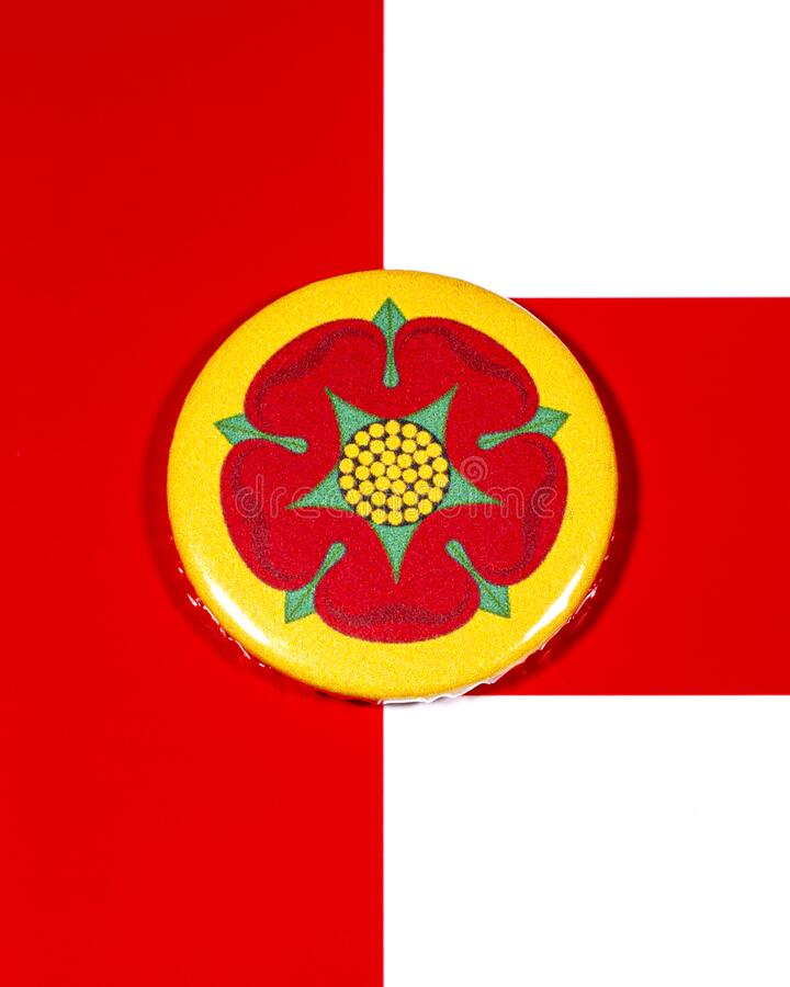Lancashire in England. A badge portraying the flag of the English county of Lancashire pictured over the England flag stock photos