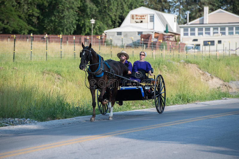 LANCASTER, USA - JUNE 25 2016 - Amish people in Pennsylvania. Amish are known for simple living with touch of nature contacy, plain dress, and reluctance to royalty free stock photography