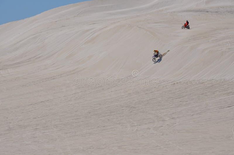 Lancelin Dunes: Motorbikes race the White Landscape in Western Australia. LANCELIN, WESTERN AUSTRALIA-OCTOBER 5,2015: White sand dune landscape in Lancelin stock photo