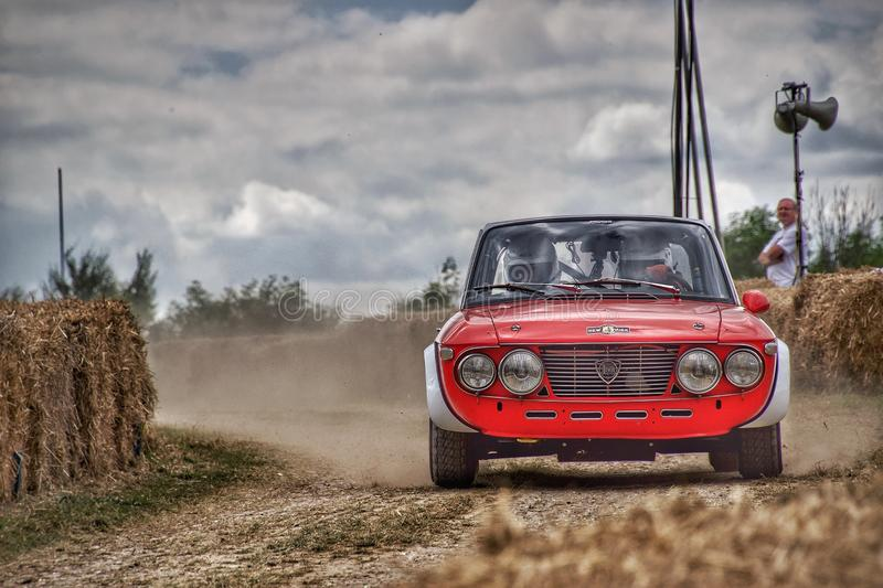 Lancia Rally in dust at Goodwood festival of speed. Lancia Fulvia at Goodwood Festival of speed stock photos