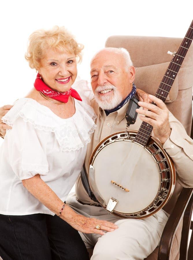 Land-Ältere mit Banjo stockbild