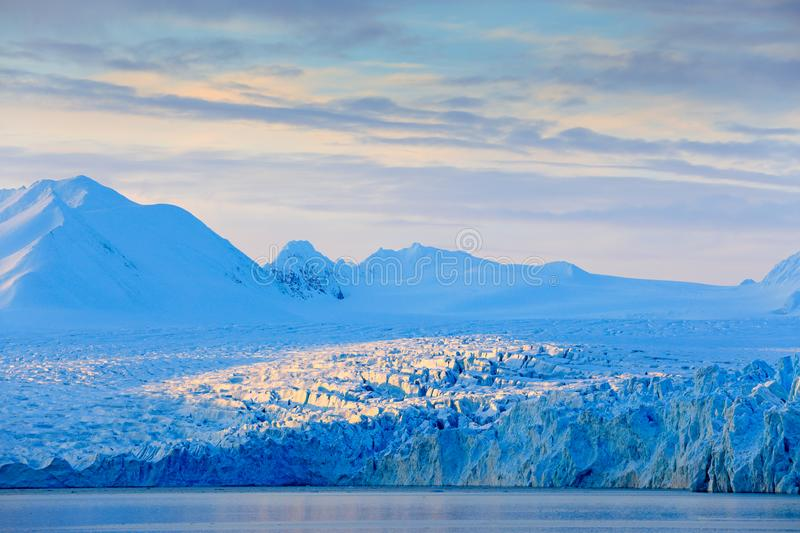 Land of ice. Travelling in Arctic Norway. White snowy mountain, blue glacier Svalbard, Norway. Ice in ocean. Iceberg in North pole stock photo