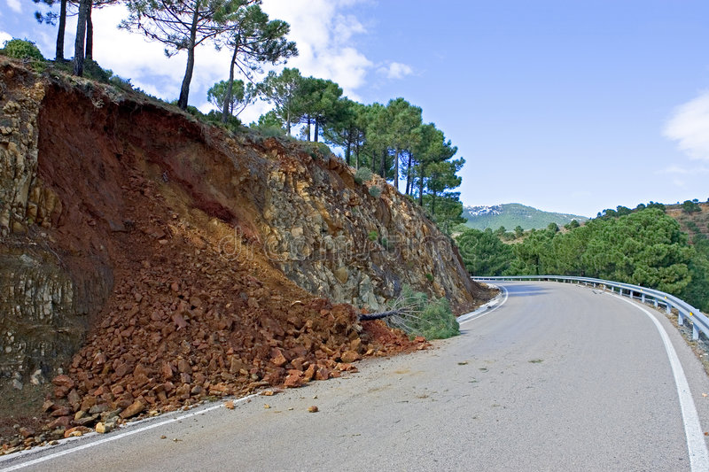 Land or mudslide on mountain road after storm royalty free stock photos
